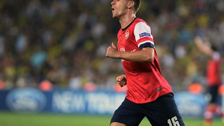 Arsenal's Aaron Ramsey celebrates after scoring against Fenerbahce. Photo: AP Photo