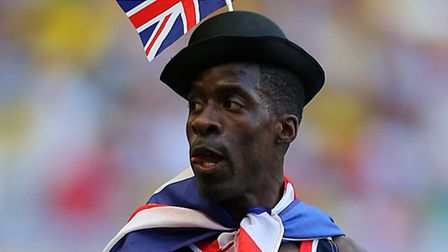 Great Britain's Dwain Chambers stands dejected after the Men's 4x100 metres relay