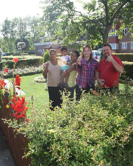 Residents of Campbell Gordon Way Residents' Association with their winning blooms