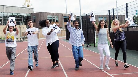 Students celebrate running along the running tarck with their A's Pic: Dieter Perry