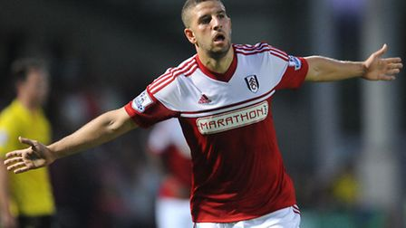 Adel Taarabt celebrates his goal for Fulham against Burton Albion on Tuesday night