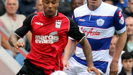 Richard Dunne (centre) in action for QPR