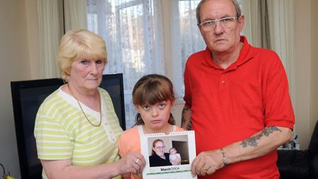 Pic of parents James and Janet Blake and grandaughter Chloe Blake 9 pictured together holding a pict