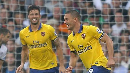 Arsenal's Lukas Podolski (centre right) celebrates scoring his side's second goal of the game