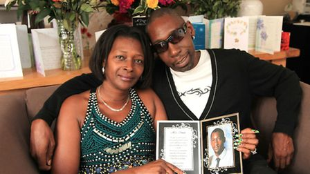Monica Campbell and Keith Payne with a photo of Arron
