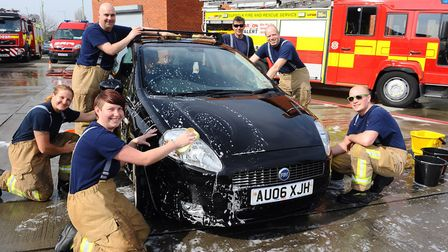 Lowestoft firefighters doing a charity car wash at the Lowestoft South fire station on Stradbroke Ro