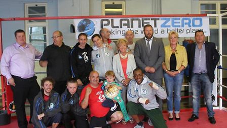 Young boxers from Caris along with Planet Zero reprasentatives and Frankie the club mascot (centre)