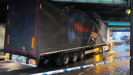 The lorry got firmly wedged under the bridge Pic: Dieter Perry
