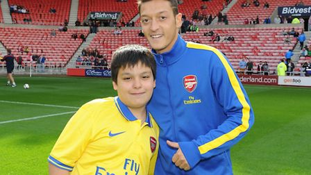 Christopher Guerra with Arsenal's new signing Mesut Ozil