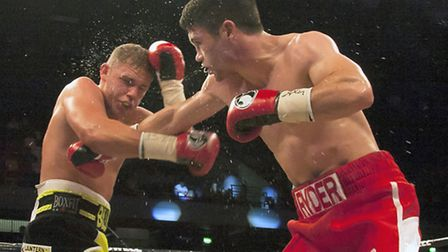 Billy Joe Saunders (left) takes a blow from John Ryder in their British and Commonwealth title fight