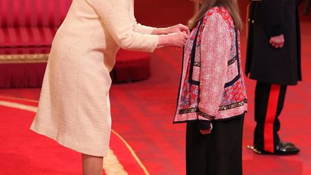Anna Scher from Islington is made an MBE by Queen Elizabeth II at Buckingham Palace.