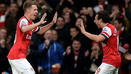 Arsenal's Aaron Ramsey (left) celebrates with team-mate Santi Cazorla after scoring his side's secon
