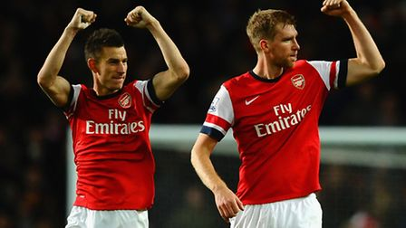 Laurent Koscielny and Per Mertesacker celebrate victory at the final whistle. Photo by Laurence Grif