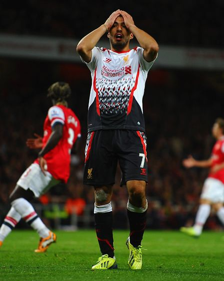 Luis Suarez reacts after a missed chance. Photo by Laurence Griffiths/Getty Images