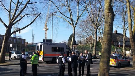 Police swarmed outside Highbury Grove School before cordoning off the nearby estate