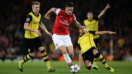 Arsenal's Olivier Giroud (centre) is tackled by Borussia Dortmund's Nuri Sahin (right) during the UE
