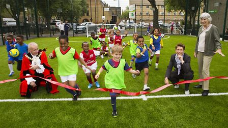 Pitch invasion - Islington Mayor Barry Edwards joins young footballers, Hannah Bladen orf Sport Engl