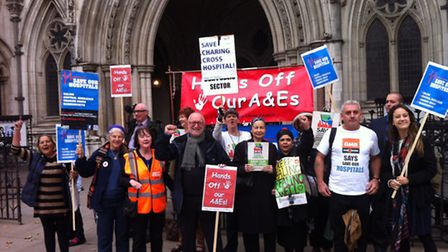 Campaigners against the downgrade of services at Ealing Hospital outside the Royal Courts of Justice