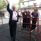 Headteacher at Duncombe Primary School, Barrie O'Shea with pupils on the current, outdated play equi