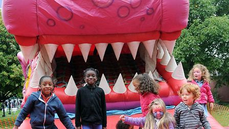 Youngsters have fun on a bouncy castle