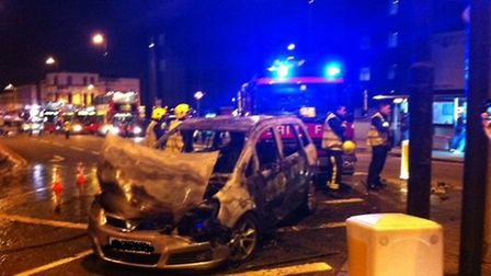 Burnt out vehicle blocks traffic on Archway Road. Picture: Kerrie Hales