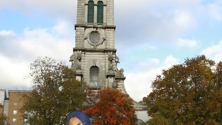 Cllr Rakhia Ismail in front of Cally Park Clock Tower