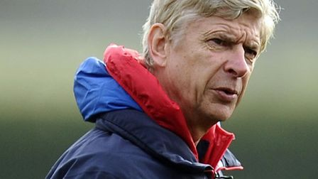 Arsene Wenger during a training session at London Colney.