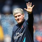 Pat Rice waves to the fans