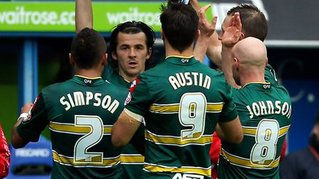 Joey Barton of QPR holds up the shirt of team-mate Alejandro Faurlin as he celebrates with team-mate