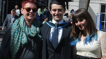 Gianni Sonvico, with mother Karen, left, and younger sister Maya