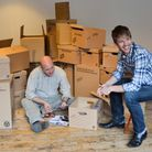 Neil Walker and Tommy Lexun look through photo props for 'Do We Do the Right Thing.' The play, by Ne