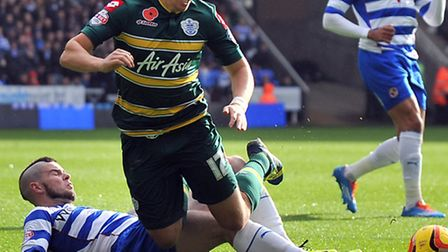 Joey Barton tangles with Danny Guthrie in QPR's draw with Reading on Saturday