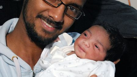 Hashim Sharif from Highbury with his new daughter, born at the Whittington Hospital at 4.46am on New