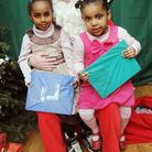 Pictured with Santa in his Grotto from left is Tesuem Hassan 4, Lydia menker 3Pic: Dieter Perry