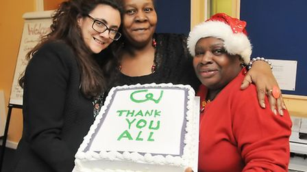 Pictured from left with cake is Natasha Sloman, head of social work, Clover Crumbie and Colleen Whit