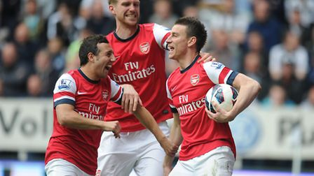 Arsenal Laurent Koscielny (right) celebrates scoring the opening goal at Newcastle