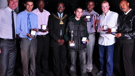 CNWL football team receiving the league title cup from the Brent Mayor