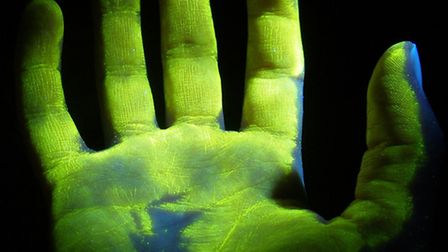 Photos of hands covered in smartwater