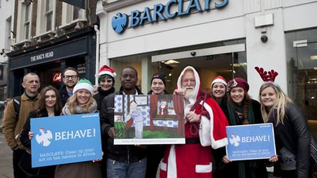 Campaigners about to deliver a giant Christmas card to Barclays on Upper Street. From left � Glenn P