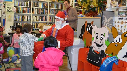 Father Christmas visits the volunteer library run by FOBL