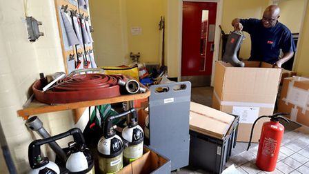 Firefighter Henry Ayanful packs up equipment at Clerkenwell, the country's oldest Fire Station, whic