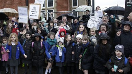 Local residents and school children demonstrate outside the closed library (pic credit: Jan Nevill)