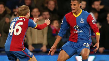Crystal Palace's Marouane Chamakh (right) celebrates his goal against Cardiff with Barry Bannan