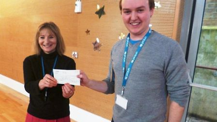 Headteacher Mandy Reese hands over the cheque to Unicef's Hywel Griffith