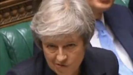 Theresa May responds to a question from Caroline Lucas in the House of Commons (Photograph: Parliame