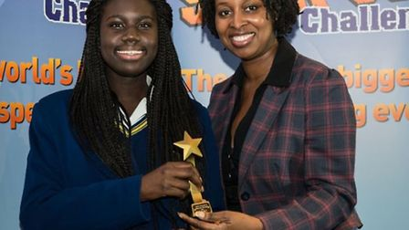 Tia Mereweather is presented with her award by Dawn Butler, Labour Prosepctive Parliamentary Candida