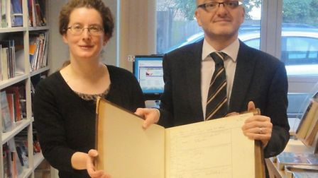 Tony Pope, from the College of North West London, handing the registers over to Rosamund King at Bre