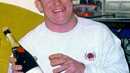 Sean Bradish poses with a bottle of champagne before he was jailed in 2002 (pic credit: Central News
