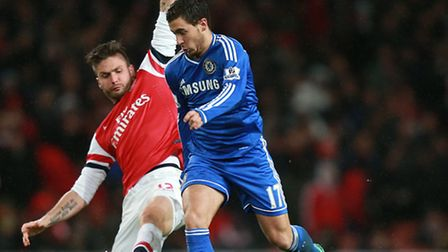 Arsenal's Olivier Giroud (left) in action against Chelsea's Eden Hazard