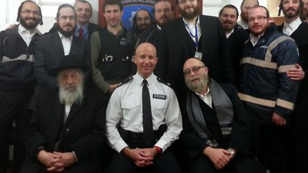 Members of the Shomrim with police.